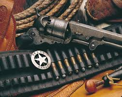 Image of the Texas Ranger, the lariat, the pistol, cartridges and the cinco peso.