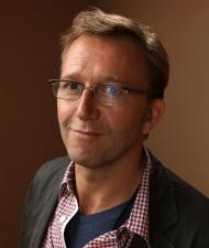 Director Carl Bessai.