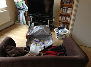 Hastily and only partially unpacked suitcase.