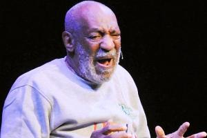 Bill Cosby performing onstage